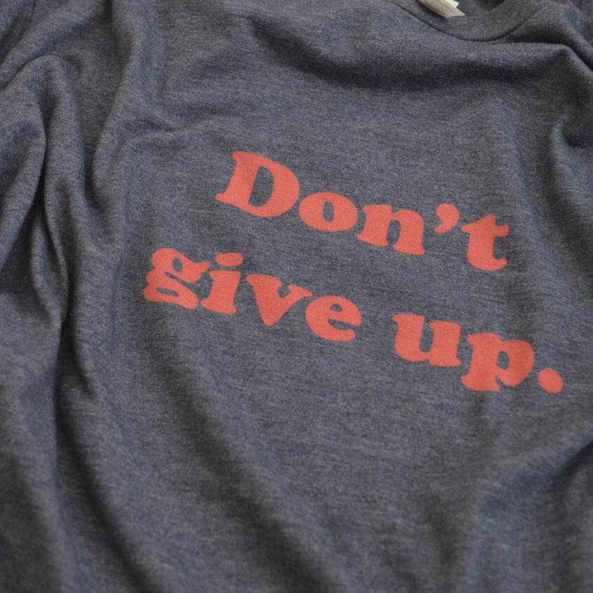 DON'T GIVE UP t-shirt - 30% of profits go to the ACLU.