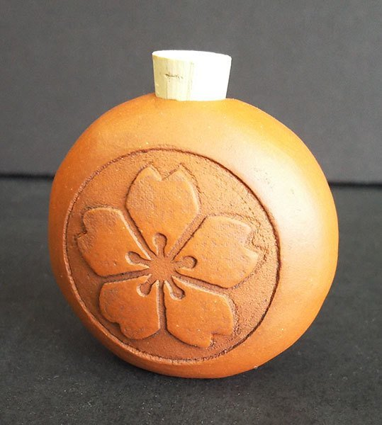 Terracotta bottle  with cherry blossom design
