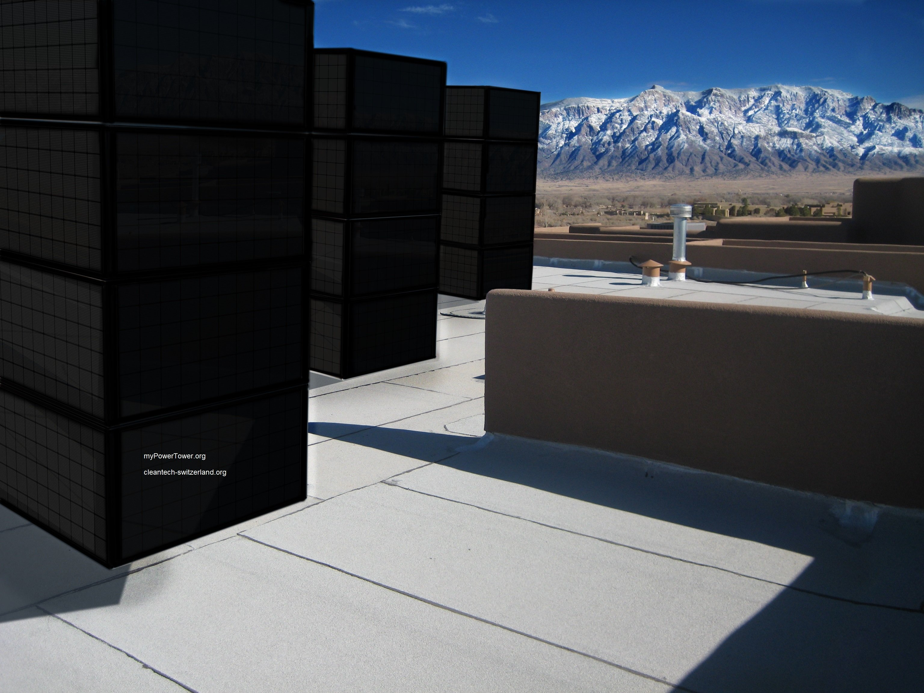 myPowerTower.org by cleantech-shop.org some on the roof of a building with black solarpannels
