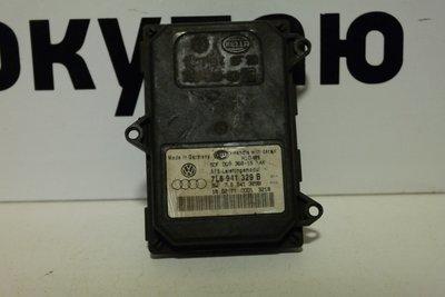 Блок адаптивного освещения Volkswagen Touareg