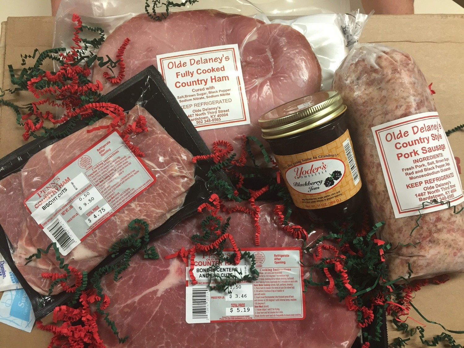 "Gift Box 1 ""Breakfast Gift Pack"" ( 1 1/2 lbs frying Ham, 1/2lb Biscuit Cut Frying Ham, 1 1/2lbs Country Sausage, 1/lb Fully cooked Country Ham, 1 Jar Blackberry Jam)"