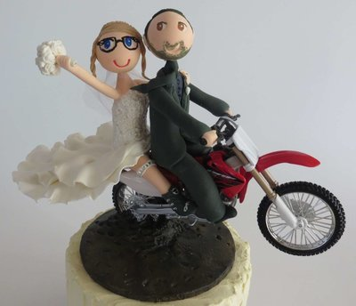 Couple Riding  Motorbike on base board