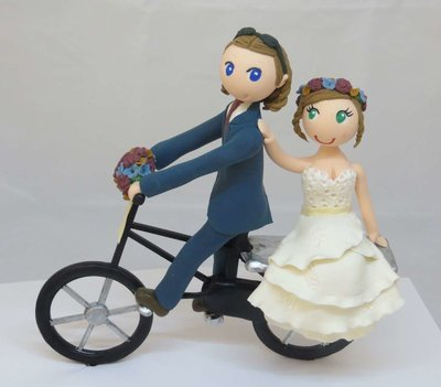 Couple on Bicycle on round base board