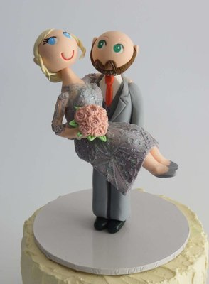 Groom  Carrying Bride  on round base board