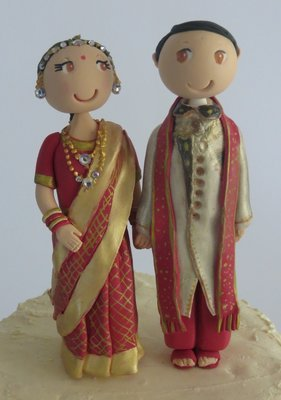 Traditional Indian Bride & Groom on round base board