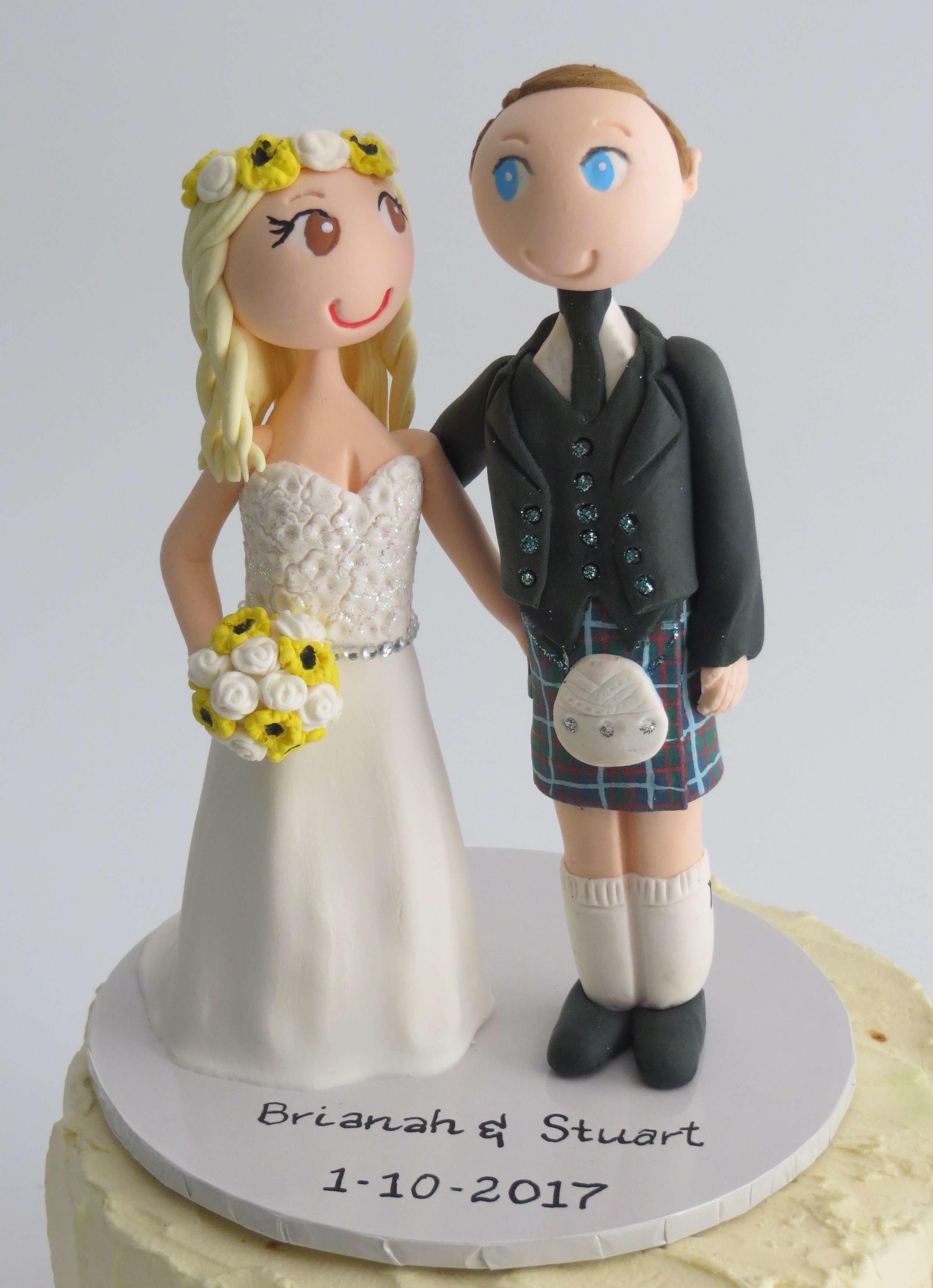 Scottish  Couple -on round base board O