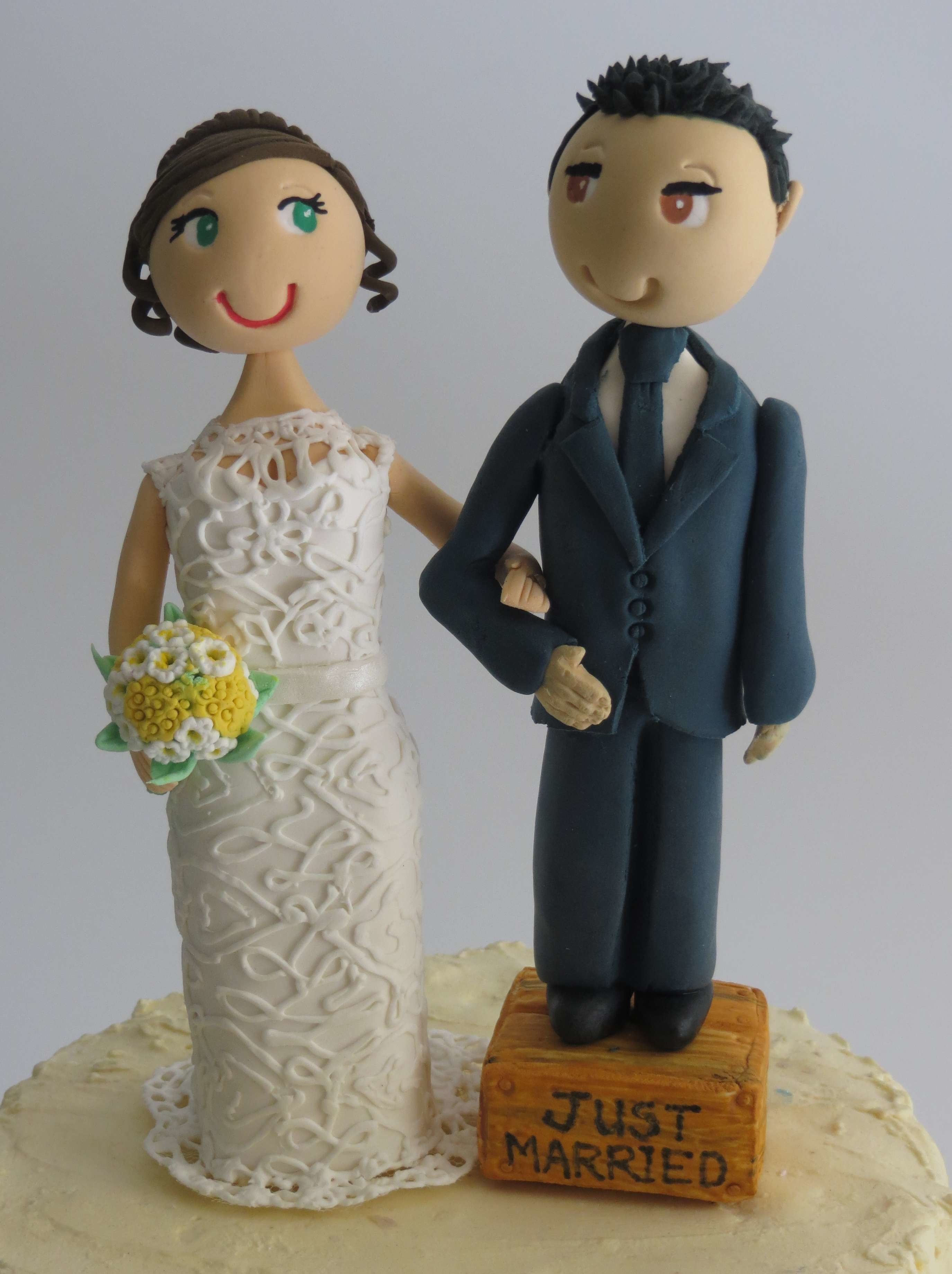 Groom standing on box Couple on round base board R