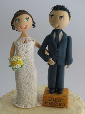 Groom standing on box Couple on round base board