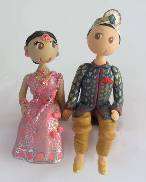 Traditional Indian Couple on round base board
