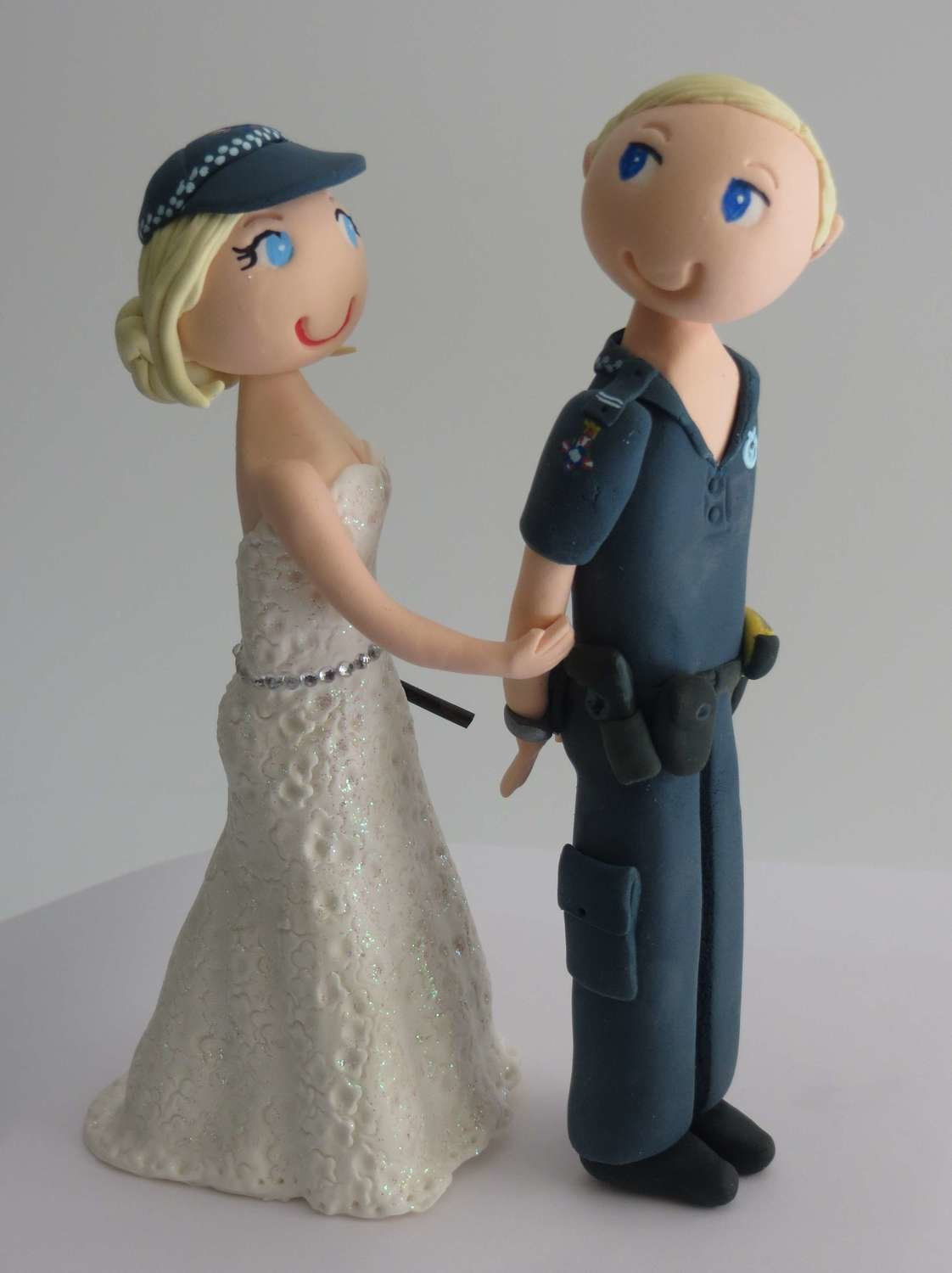 Bride arresting Police Groom on round base board