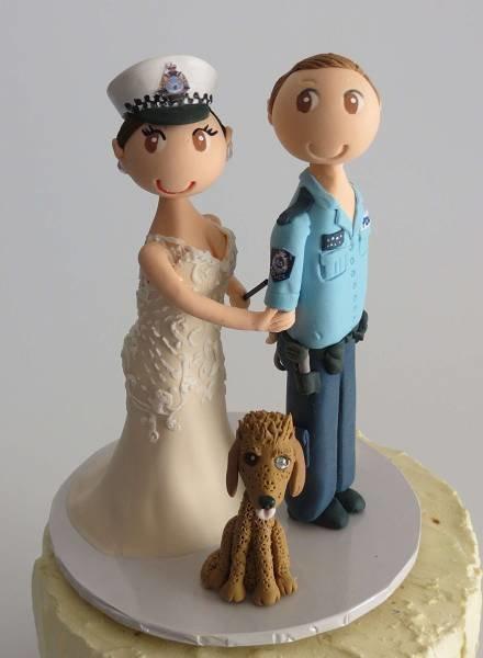 Bride arresting Police Groom on round base board
