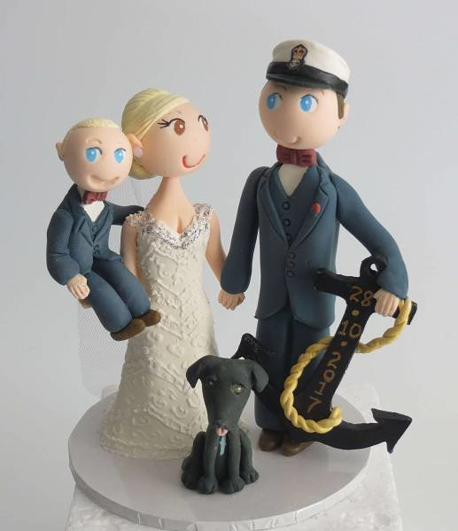 Standing Couple with 1 child on round base board