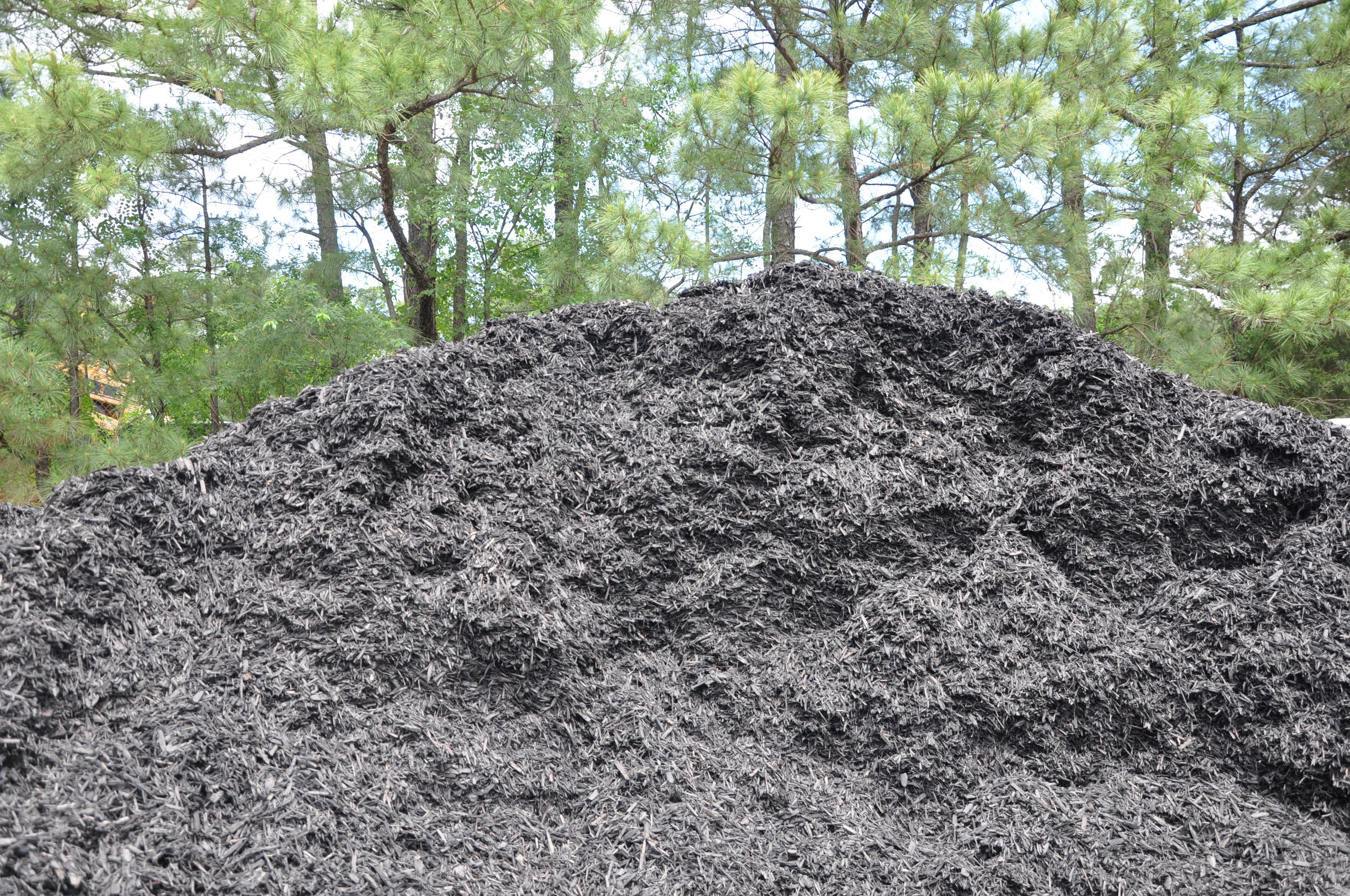 Mulch triangle landscape supplies mulch stone soil for Landscaping rocks wake forest nc