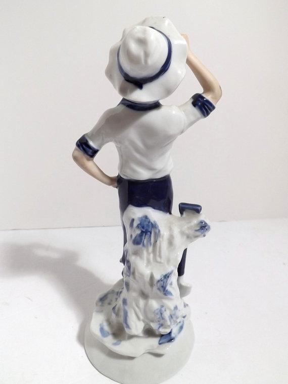 boy with shovel figurine