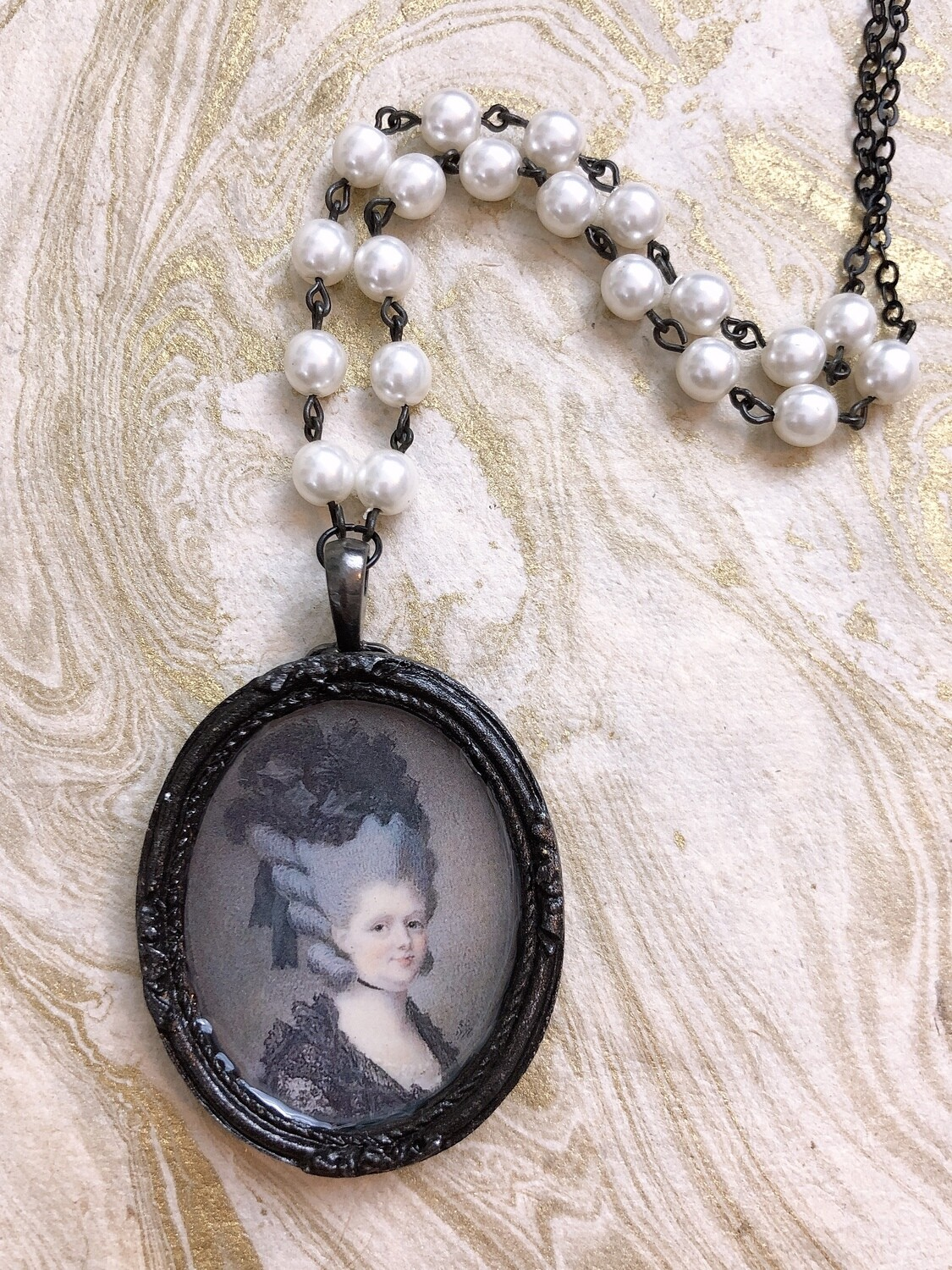 frame necklace (lady in black)