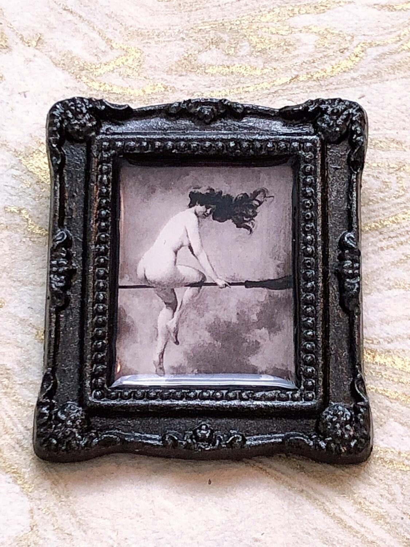 frame brooch (witch in flight)