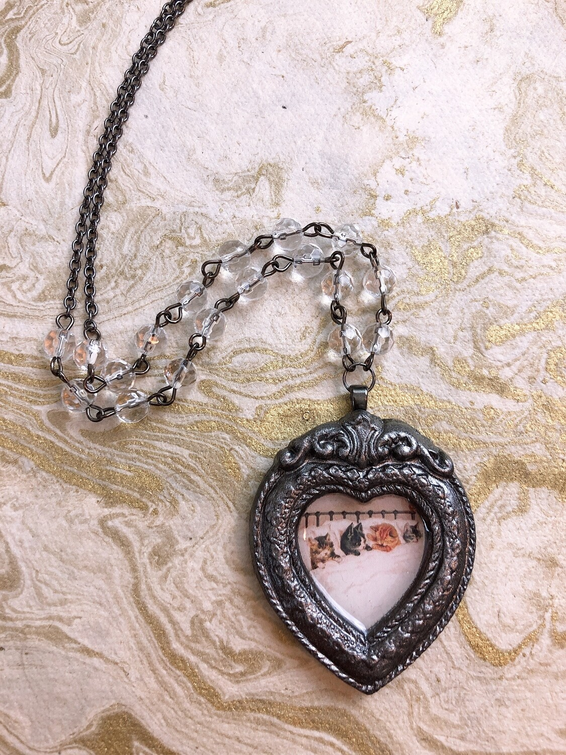 frame necklace (cats in bed)