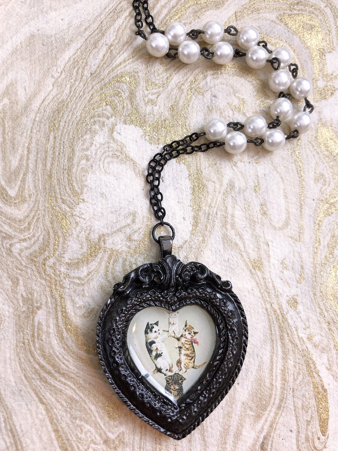 frame necklace (circus cats)