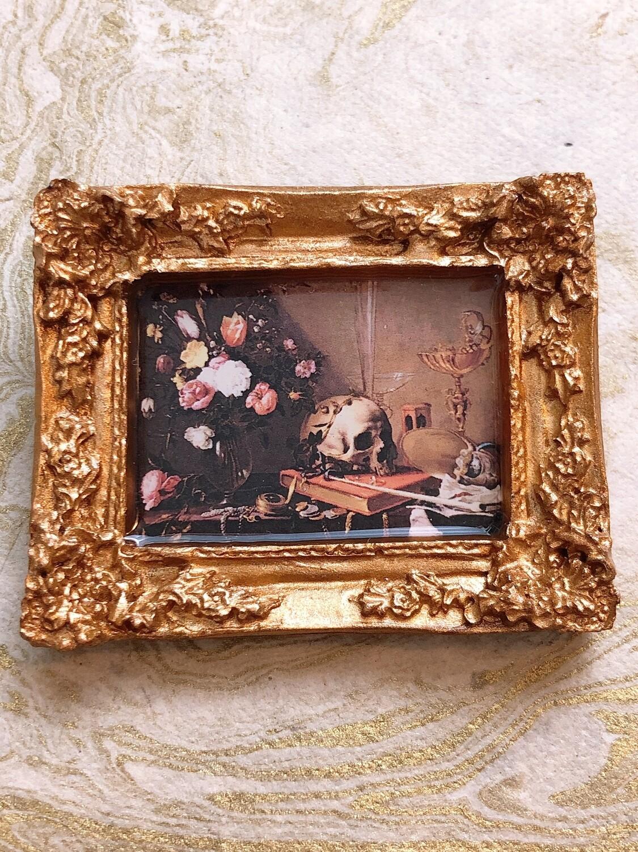 frame brooch (gold vanitas)