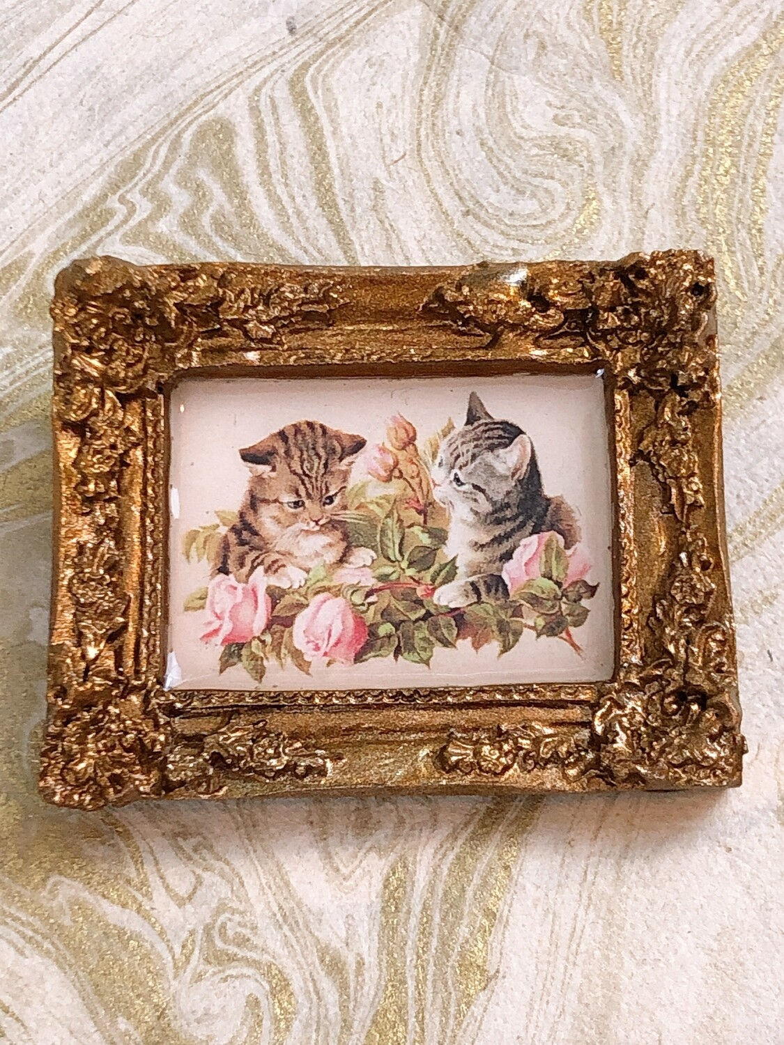 frame brooch (cats and roses)