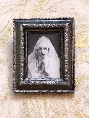 frame brooch (the nun)