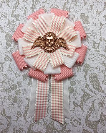 pink cherub rosette
