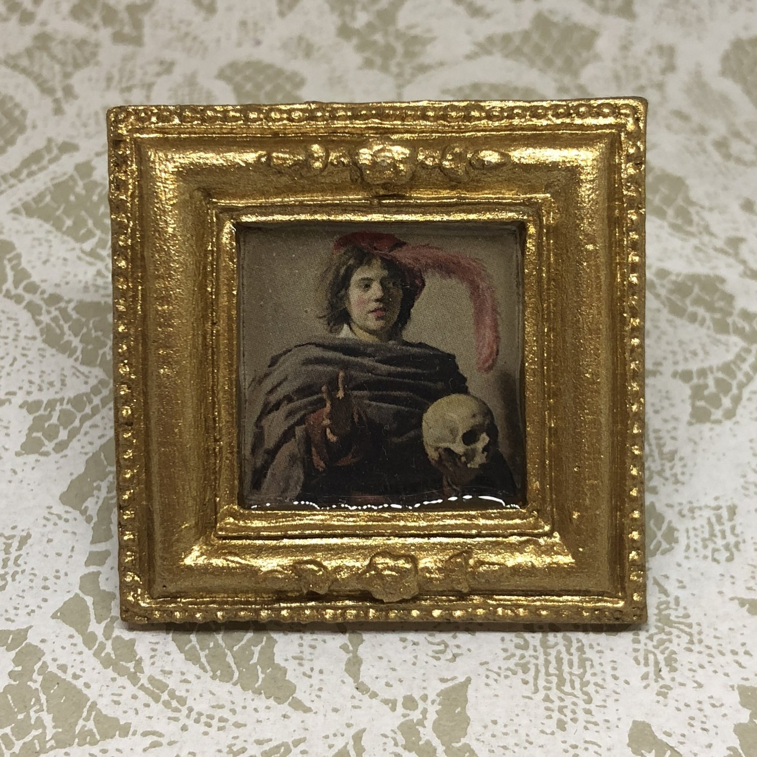 portrait frame brooch (young man with skull)