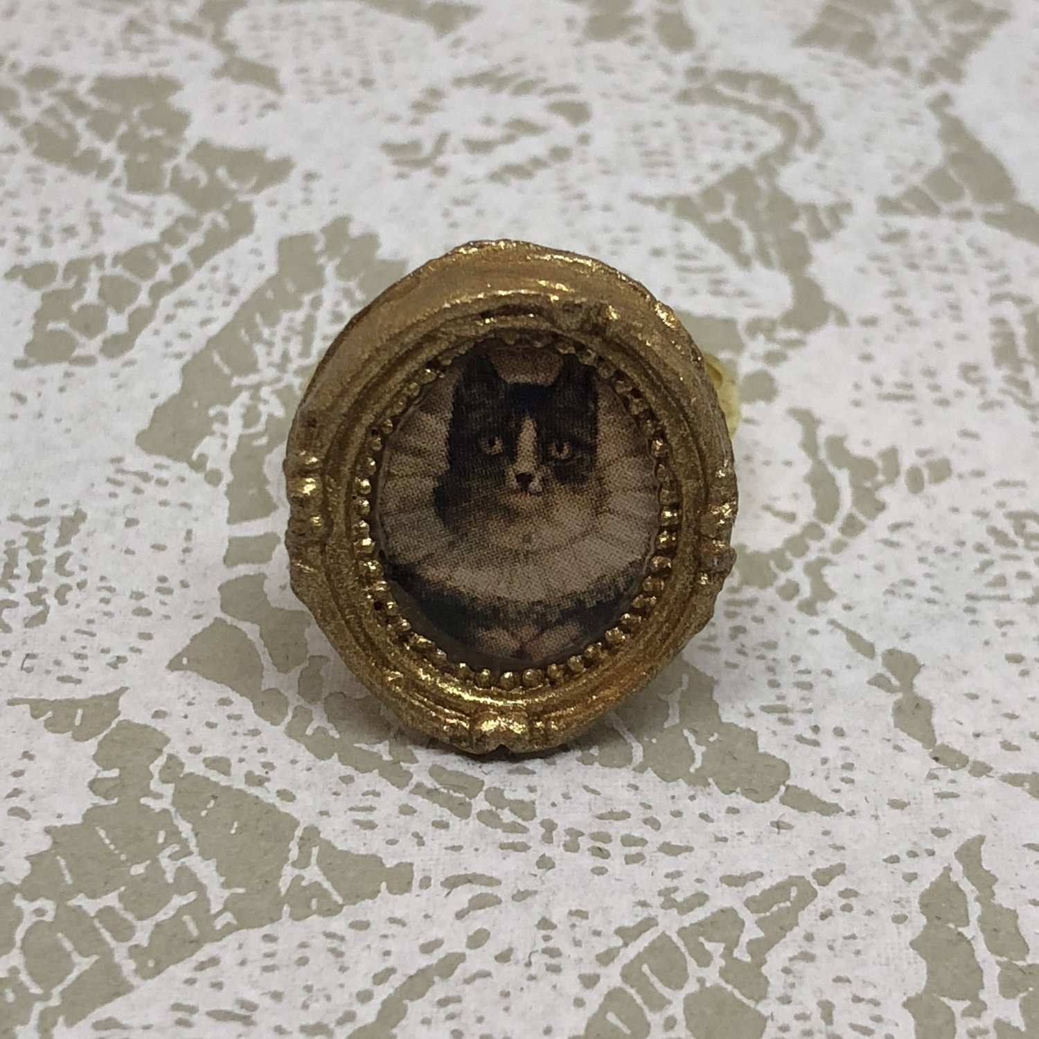 portrait frame ring (the widow)