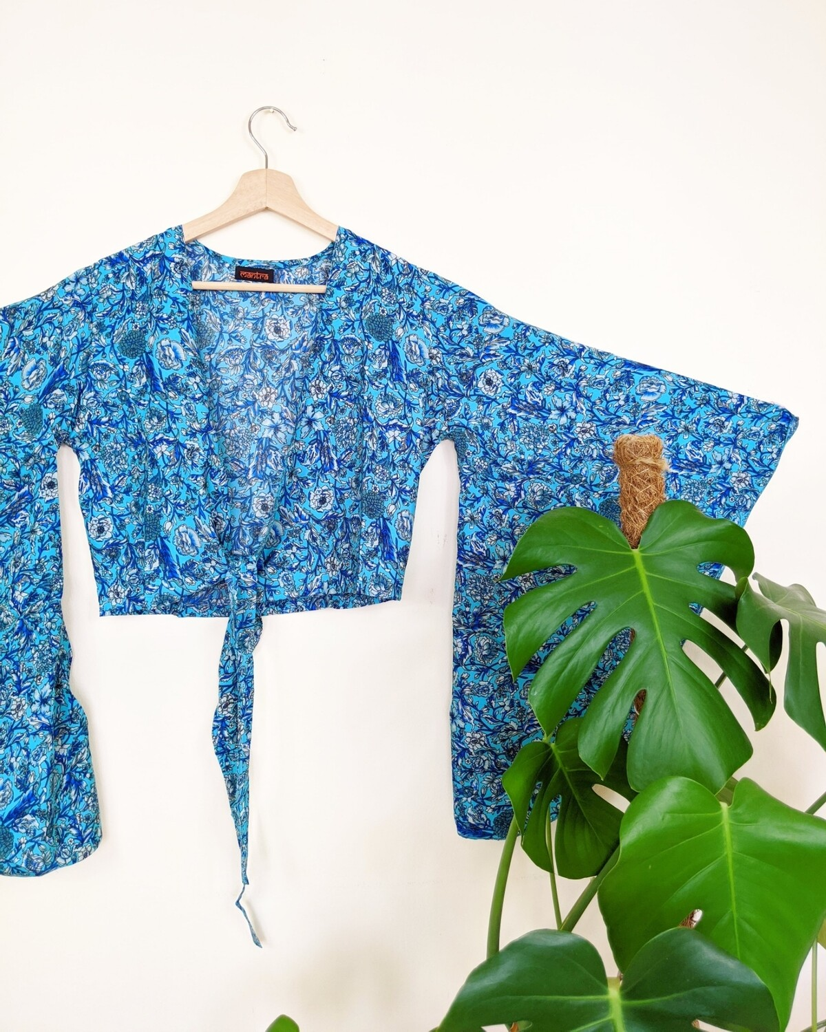 BLUE FLORAL BUTTERFLY SLEEVE WRAP TOP