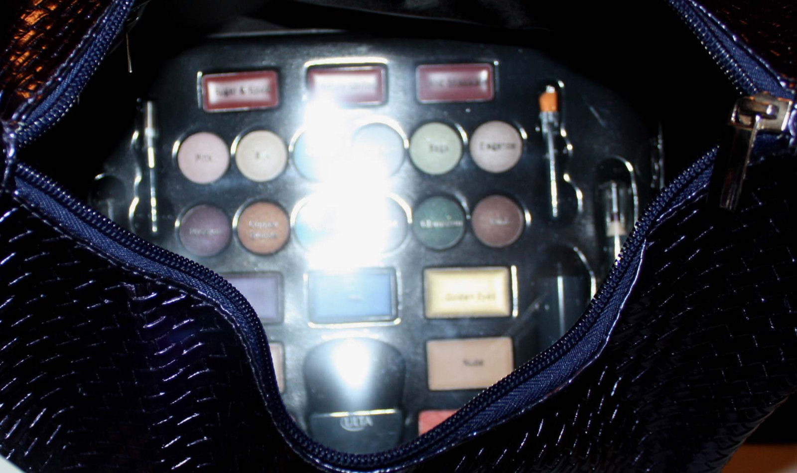 makeup palette inside upper zippered compartment