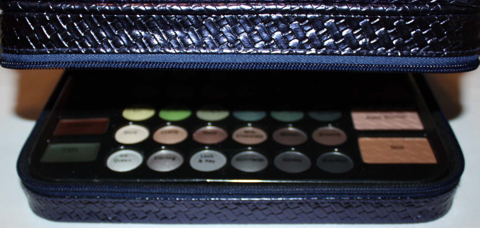 makeup palette inside lower zippered compartment