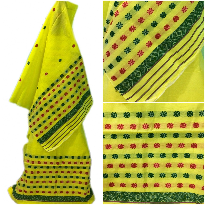 Beautiful Buwa Mekhela Chador in lemon yellow colour with red & green buti and pari