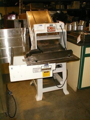 Oliver 797G-32 floor model gravity feed 1/2 cut bread slicer with bagger