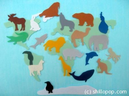 Карта мира и силуэты животных