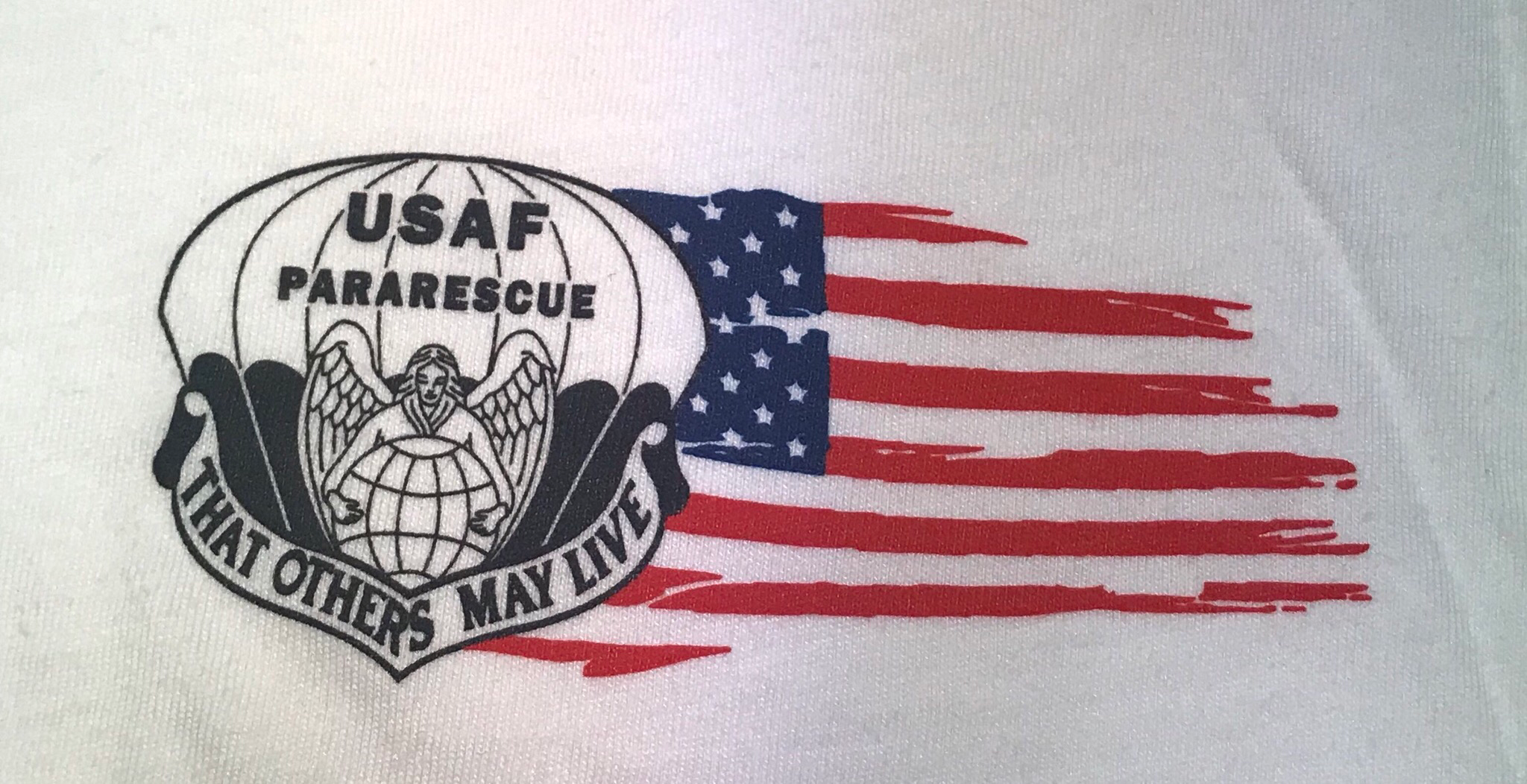 "pja/ White T-Shirt with ParaRescue Flash and Tattered Flag left chest. PJ Association ""Guardian Angel"" on back...Large 01-0043"