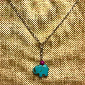 The G.U.T Charmspire™ Necklace with Turquoise Elephant