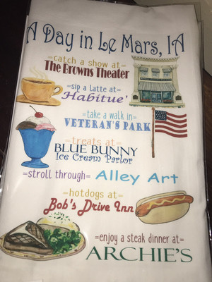 A Day In Le Mars Dish Towel