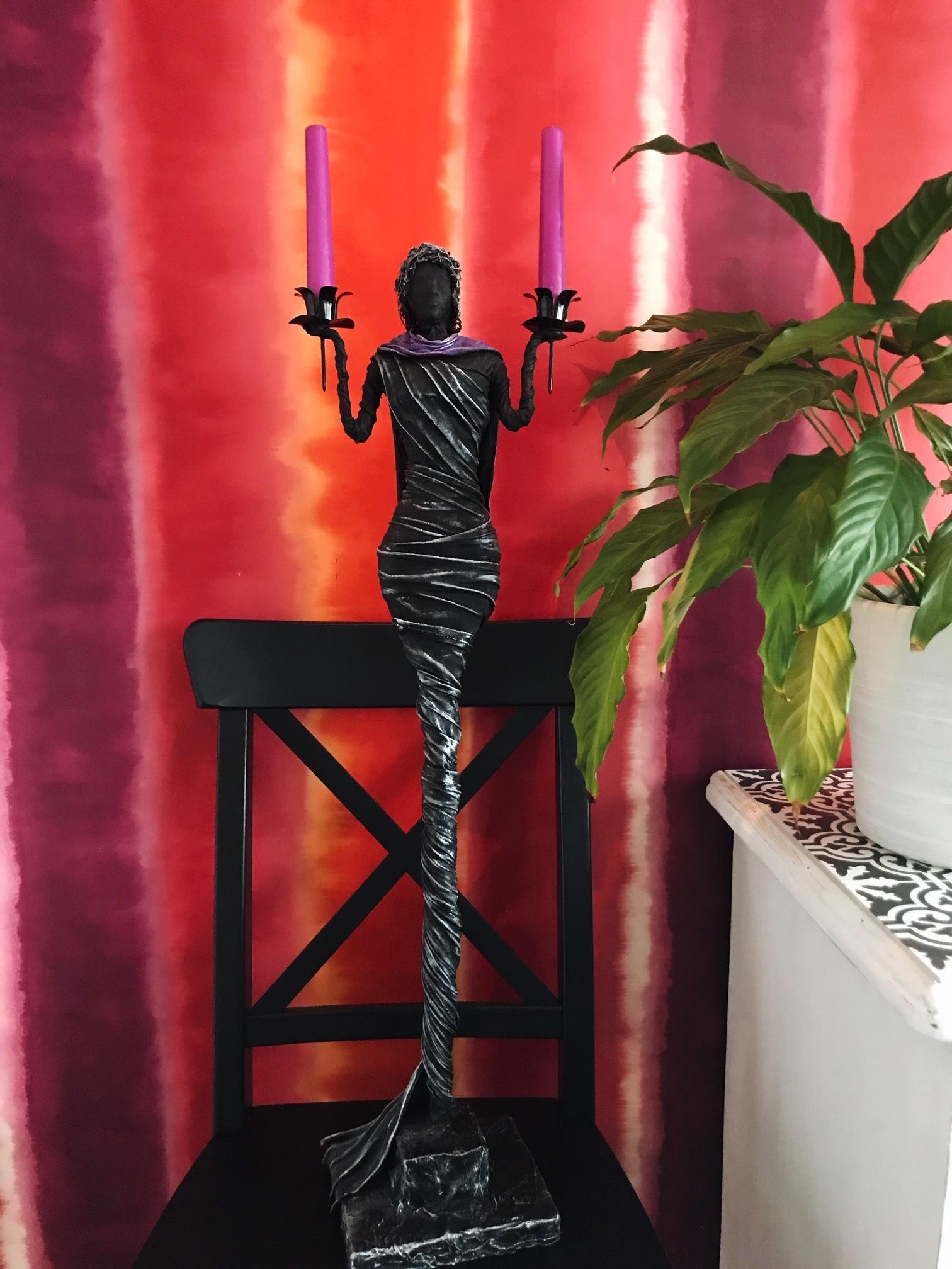 """Skulptur """"Ljusbäraren"""""""