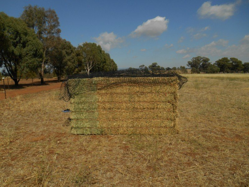 Secondly, open up and lay the entire net out along the top of the bale
