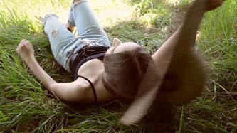Girl Lies On Shady Summer Grass     -19    18 CV23P