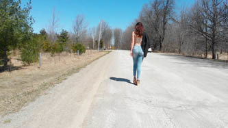 Girl Walks down Road, Turns     33    CV31P