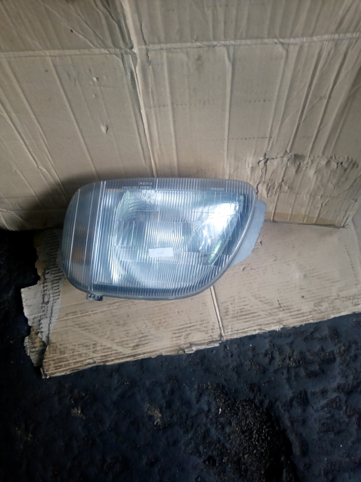 Nissan march headlight 00103