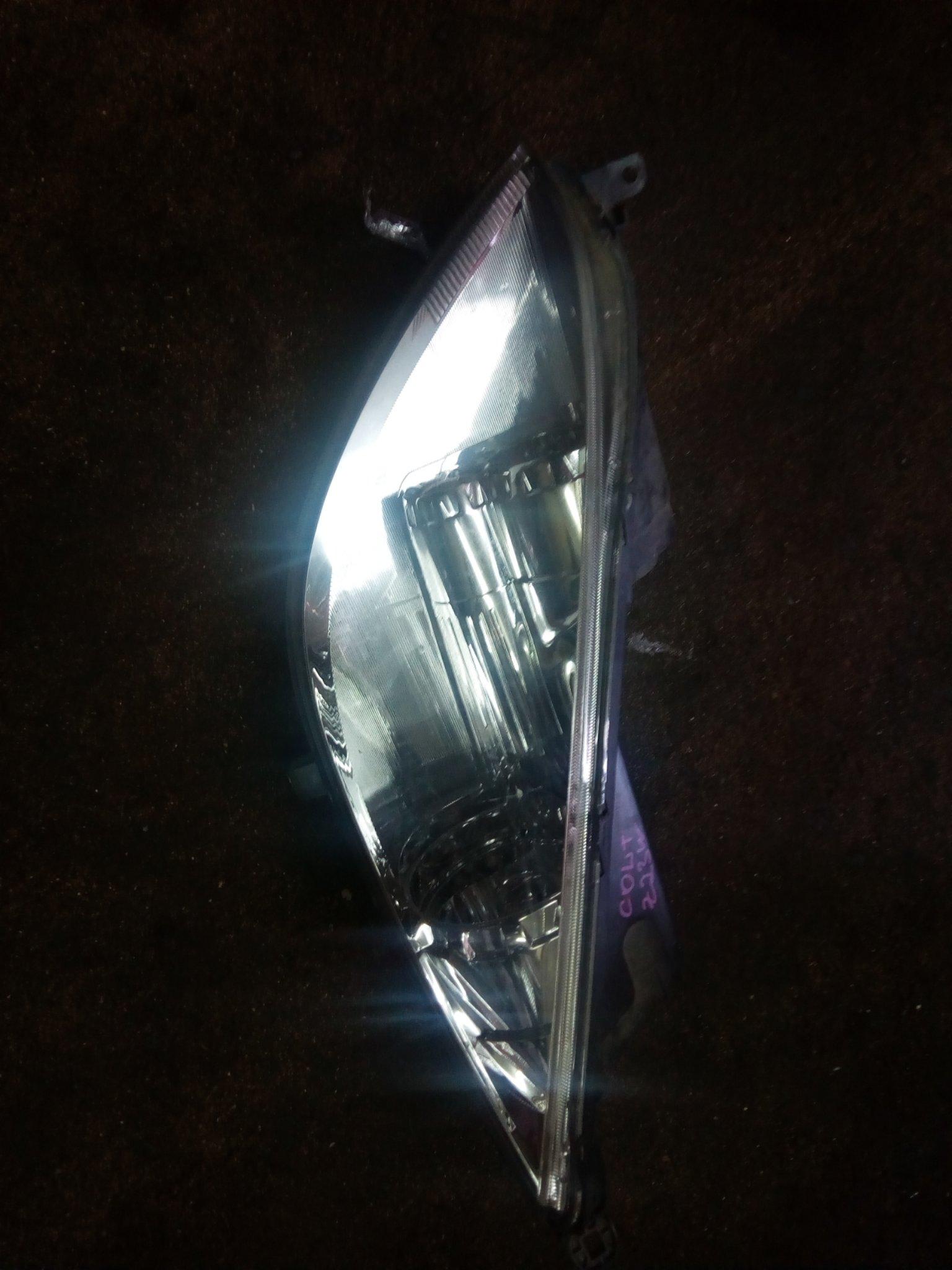 Mitsubish colt head light 00855