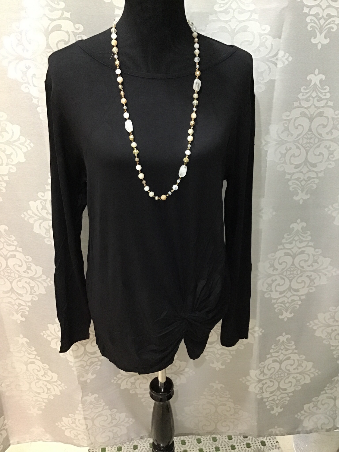 Black long sleeved top with knotted bottom