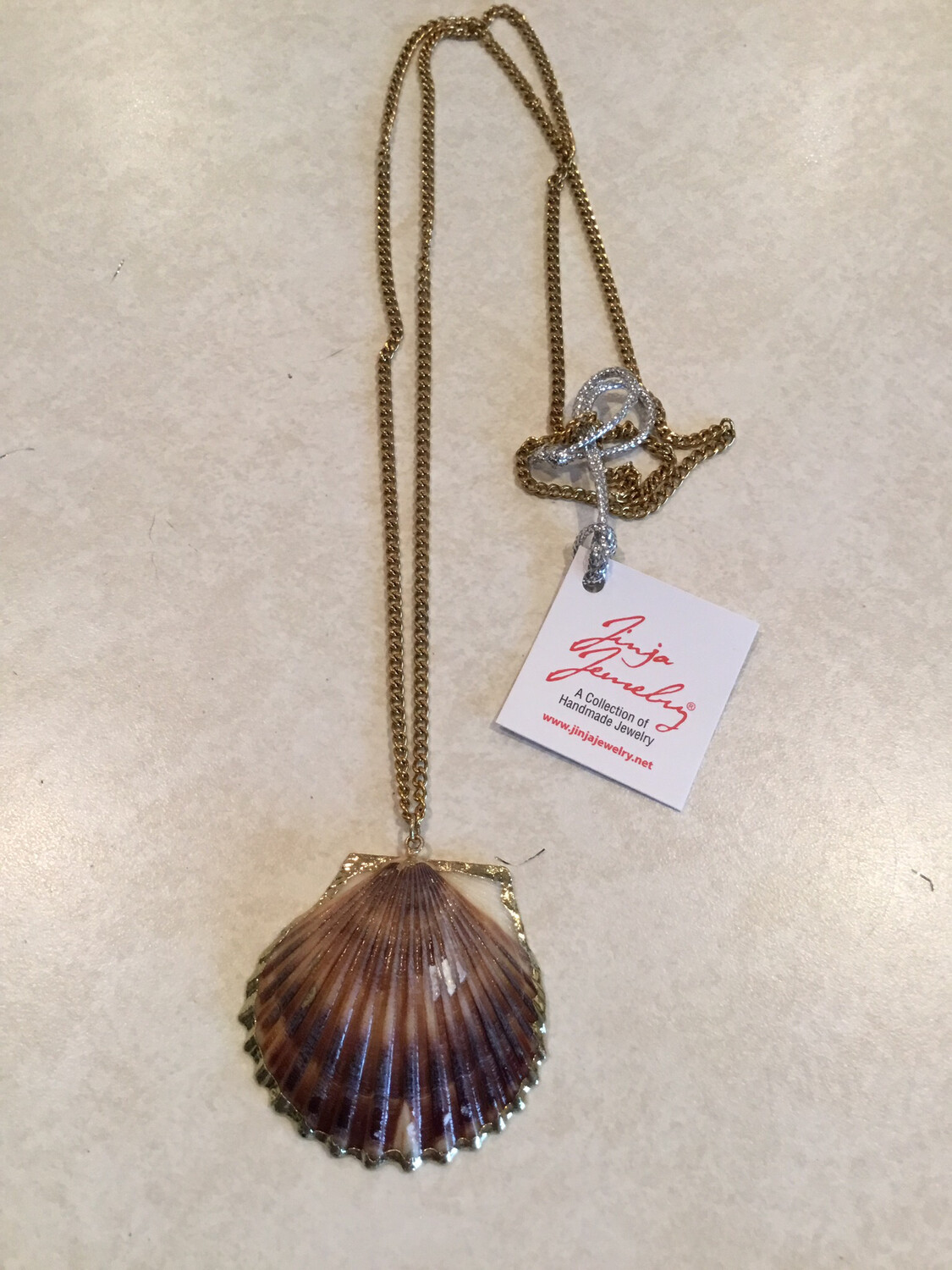 Natural Fan Shell In Cased In 24K Gold Plating On Nickel And Lead FREE Gold Chain.