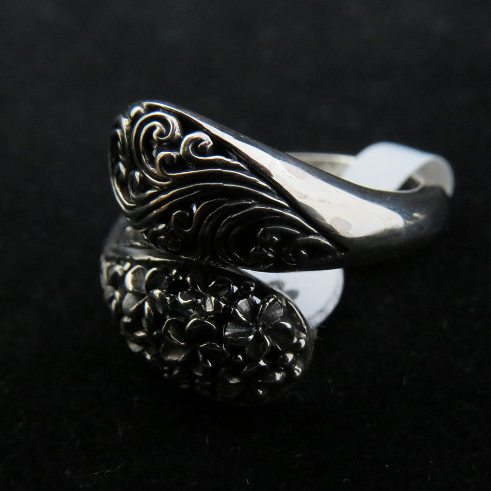 Sterling Silver Cross Over with Frangipani Ring R-09212