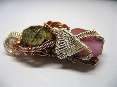 Wire wrapped raw ruby and Tsavorite Garnet pendant