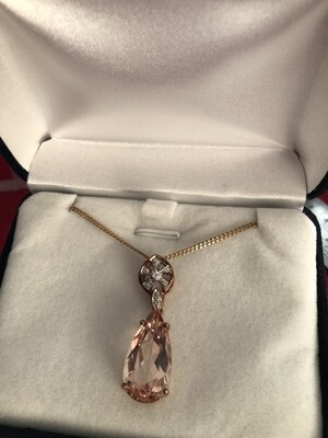 9k Yellow Gold Necklace with Diamonds a large Morganite Stone in an elegant setting