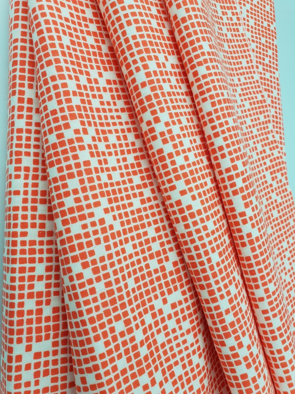 Orange med lyse firkanter