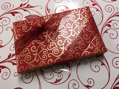 Send Some Love!  Chocolate Love!  An Assortment of our most popular Chocolates for Valentine's Day.  Wrapped with a beautiful bow and solid chocolate hearts added.  FREE SHIPPING